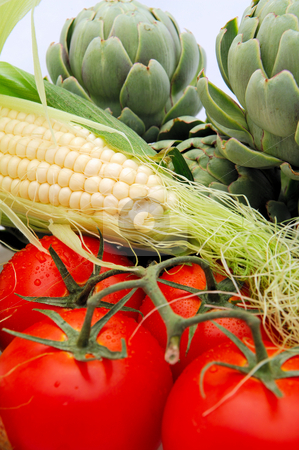 Fresh Vegetables stock photo, Artichokes, vine riped tomatoes and fresh corn on the cobb are part of a healthy diet by Lynn Bendickson
