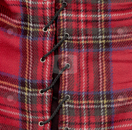 Tartan stock photo, Woolmaterial  tartan-look in red with a cord by J?