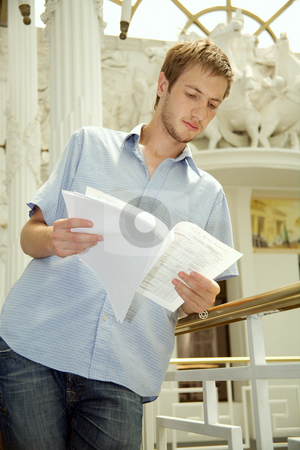 Businessman stock photo, Business the man studies the report of commercial activity. by Sergey Goruppa