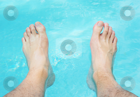 Relaxing Feet in Water stock photo, Two feet relaxing in the swimming pool water. by Denis Radovanovic
