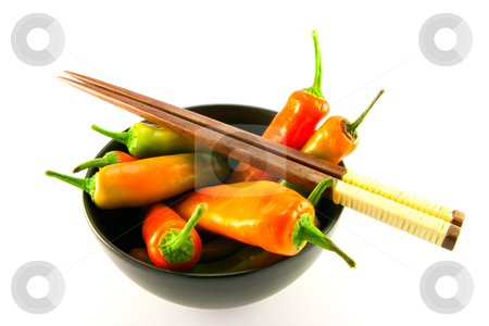 Chillis in a Black Bowl with Chopsticks stock photo, Mixed red and green chillis in a black bowl and chopsticks with clipping path on a white background by Keith Wilson