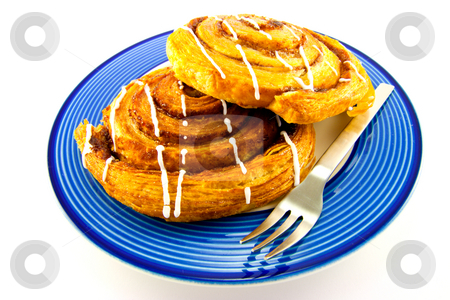 Cinnamon Buns on a Blue Plate stock photo, Two cinnamon buns on a blue plate with fork with clipping path on a white background by Keith Wilson