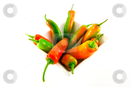 White Bowl of Chillis stock photo, Red and green chillis in a white square bowl with clipping path on a white background by Keith Wilson