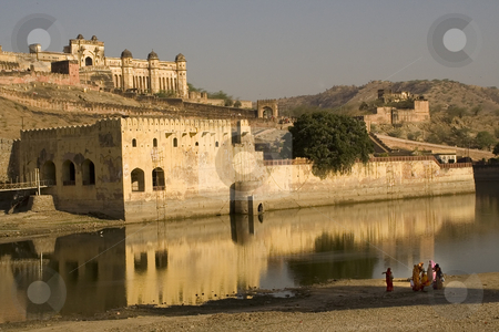 Amber Fort With Indian Women with Saris stock photo, Amber Fort with Pond and Reflection, Early Morning, Indian Women with saris by William Perry