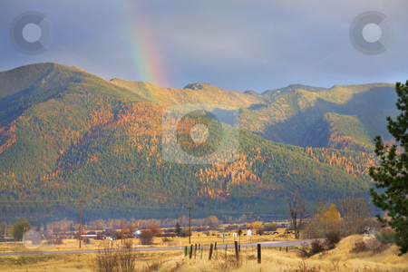 Montana Gold Rainbow Yellow Tamarack Trees in the Hills Fall Col stock photo, Montana Gold Rainbow Over Tamarack Trees Fall Colors Farms Missoula Montana by William Perry