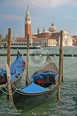 Gondolas moored by the Piazzetta di San Marco in Venice stock photo, Gondolas moored by the Piazzetta di San Marco in Venice with the Isola di San Giorgio Maggiore across the canal in the background vertical by Stephen Goodwin
