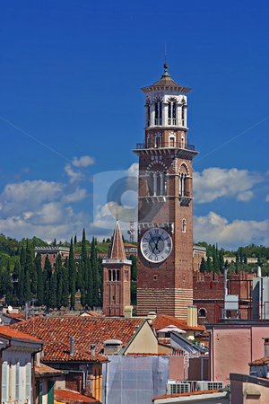 Lamberti Tower on the skyline of Verona, Italy stock photo, Lamberti Tower with the spire of the Church of Santa Anastasia in the background against blue sky and clouds on the skyline of Verona, Italy by Stephen Goodwin