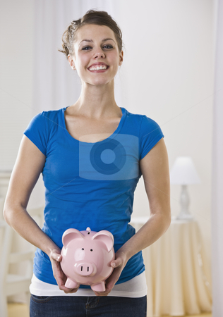 Beautiful woman holding piggy bank. stock photo, Beautiful woman holding piggy bank. Vertically framed shot. by Jonathan Ross
