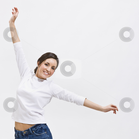 Woman with Outstretched Arms stock photo, An attractive young woman posing with outstretched arms. She is smiling and is looking directly at the camera. Square framed photo. by Jonathan Ross