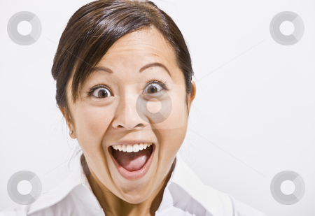 Asian woman with a surprised Look. stock photo, Asian woman surprised with open mouth. Horizontally framed. by Jonathan Ross