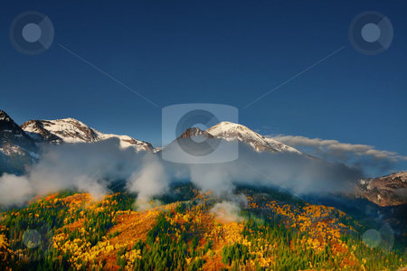 Fall Splender 45 stock photo, Mountain peak showing snow and fall colors by Mark Smith