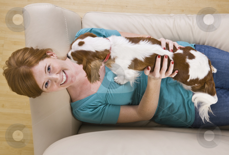 Attractive woman and dog. stock photo, Attractive woman and dog on couch. Top view, horizontally framed shot. by Jonathan Ross