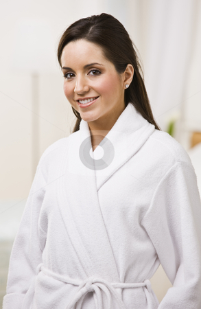 Attractive female in a bathrobe. stock photo, Attractive brunette female in white bathrobe. Vertically framed shot. by Jonathan Ross