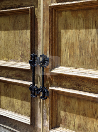 Rustic wooden doors with metal handles stock photo, Close-up view of rustic weathered wooden doors with iron metal handles by Jill Reid