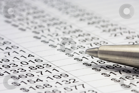 Financial report and pen stock photo, Financial data with a pen. Close up by Gabriele Mesaglio