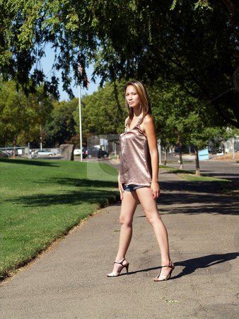 Asian American woman outdoors at park shorts stock photo, Asian American woman in shorts and heels by Jeff Cleveland