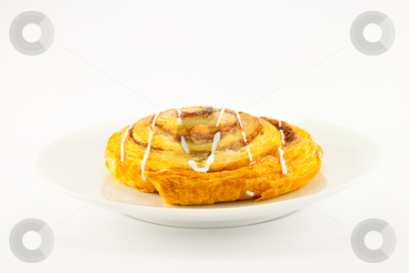 Cinnamon Bun on a White Plate stock photo, Single cinnamon bun on a plate with clipping path on a white background by Keith Wilson