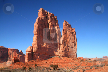 Court House Rock Arches National Park stock photo, View of the red rock formations in Arches National Park with blue sky by Mark Smith