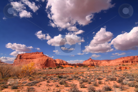 Desert stock photo, View of the red rock formations in Arches National Park with blue sky by Mark Smith