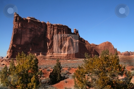 Red Rock Dsesert stock photo, View of the red rock formations in Arches National Park with blue sky by Mark Smith