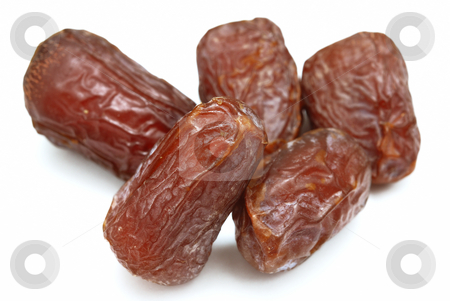 Dates stock photo, Five dry dates isolated on white background. by Denis Radovanovic