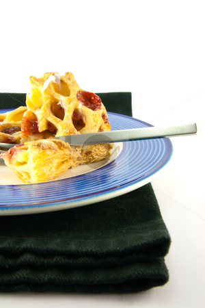 Raspberry Danish on a Plate stock photo, Raspberry and custard danish on a blue and white plate with a fork and black napkin on a white background by Keith Wilson