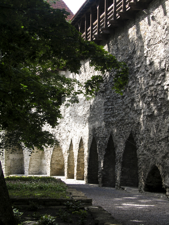 Defense wall in the old town of Tallinn stock photo, A shot of the great defense system of the Medieval old town of Tallinn, Estonia by Alessandro Rizzolli