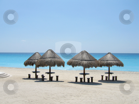 Palapas on beach stock photo, Palapas on stunning blue beach of Cancun by Shi Liu
