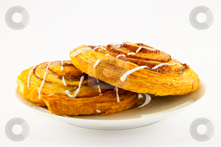 Two Cinnamon Buns on a White Plate stock photo, Two cinnamon buns on a plate with clipping path on a white background by Keith Wilson