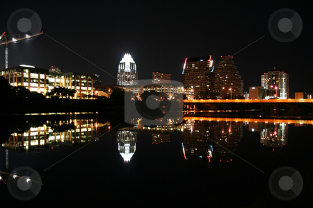 Austin Texas at Night stock photo, A night shot of downtown Austin, Texas with a construction crane on the left. by Brandon Seidel