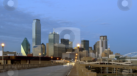Dallas Texas stock photo, Downtown Dallas Texas at night just after sunset.  Traffic is coming at the camera and creates a nice blur. by Brandon Seidel