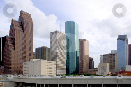 Downtown Houston stock photo, Downtown houston texas with a cloudy sky by Brandon Seidel