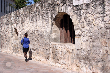 Business Woman Walking by the Alamo stock photo, Business woman walking by the Alamo by Brandon Seidel