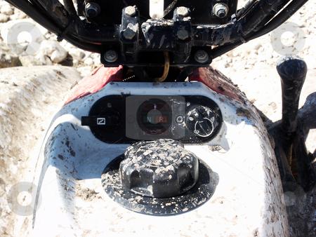 ATV Dashboard stock photo, A close up shot of the muddy dashboard on an ATV. by Brandon Seidel