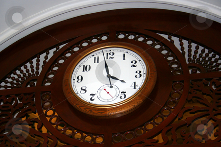 Clock stock photo, A wooden clock mounted on the ceiling of the state capitol building. by Brandon Seidel