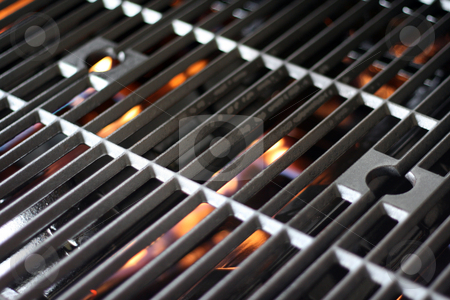 Hot Grill and Fire stock photo, A hot grill getting fired up for barbecue by Brandon Seidel