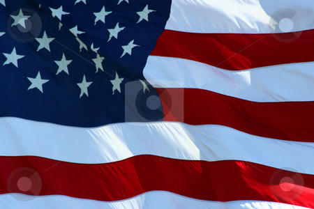 American Flag stock photo, An American flag flaping boldly in the wind. by Brandon Seidel
