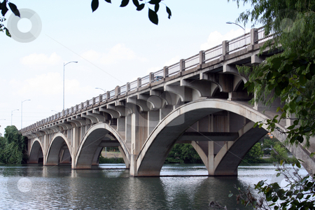 Historic Lamar Bridge in Downtown Austin, Texas stock photo, This picture was taken from the running track next to the Lamar bridge in downtown Austin, Texas.  It was a nice clear sunny day in Austin. by Brandon Seidel