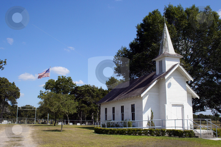 Small Rural Church in Texas stock photo, A small rural church in Texas.  There is a cemetary and a large oak tree behind the church. by Brandon Seidel