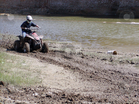 ATV Muddy Trails stock photo, A shot of a young man running some muddy trails on his ATV. by Brandon Seidel