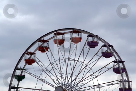Ferris Wheel against a cloudy sky stock photo, A ferris wheel against a cloudy sky by Brandon Seidel