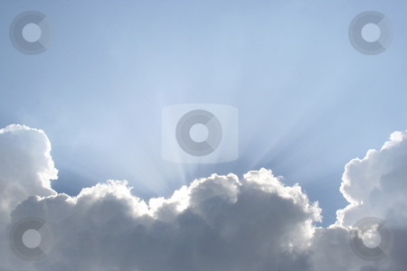 Heavenly Light stock photo, The sun shining out from behind the clouds. by Brandon Seidel