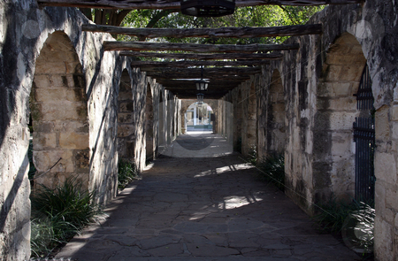 Alamo Path stock photo, A covered walkway on the Alamo that leads to the street. by Brandon Seidel