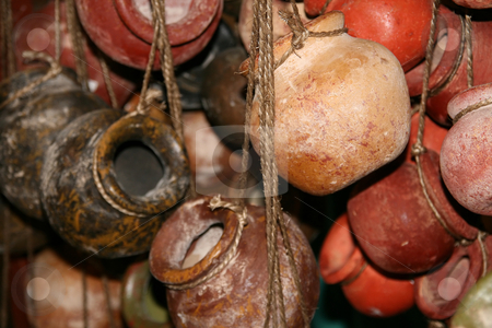 Hanging Clay Mexican Pots stock photo, Multiple strands of hanging clay mexican pots. by Brandon Seidel
