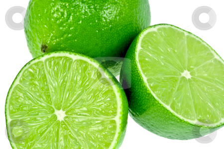 Green Limes stock photo, Two very green limes isolated on a white background.  One is cut in half. by Brandon Seidel