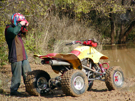 ATV Muddy Trails stock photo, A shot of a young man riding some muddy trails on his ATV. by Brandon Seidel