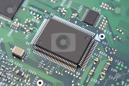 Computer Mainboard stock photo, A shot of a new computer mother board.  This image is a nice background image for print material related to computer technology. by Brandon Seidel