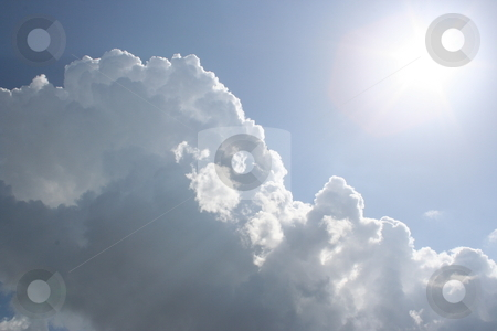 Clouds and the Sun stock photo, A bright sun beats down on the clouds in the sky after a nice rain by Brandon Seidel