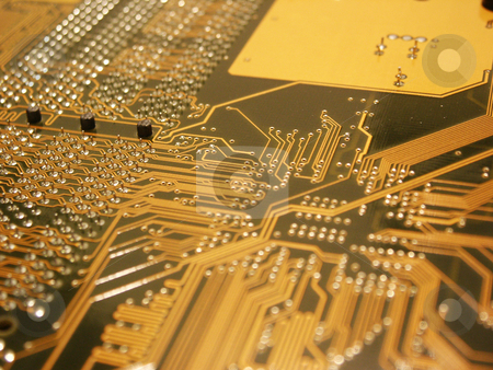 Computer Mainboard stock photo, A shot of the back side of a new dual processor computer mother board.  This image is a nice background image for print material related to computer technology. by Brandon Seidel