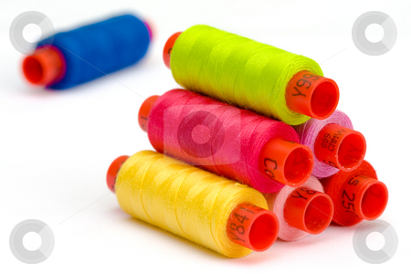 Multicolor yarn bobbins stock photo, Macro picture of yarn bobbins of different colors by Hieng Ling Tie